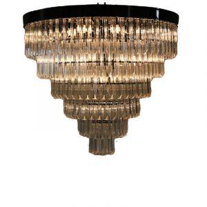 De Athena is een riante en chique plafondlamp met helder kleur glazen staven. De staven hebben een unieke vorm waardoor de lichtval werkelijk prachtig is. De rand van de lamp is in de kleur antraciet. Wil je echt een mooie en grote eye catcher in huis ga dan voor de Athena plafondlamp Extra informatie: - 8 x E14 fittingen - Afmeting 80 cm dia en 60 cm hoog - Artikel is dimbaar ( dimmer niet meegeleverd )